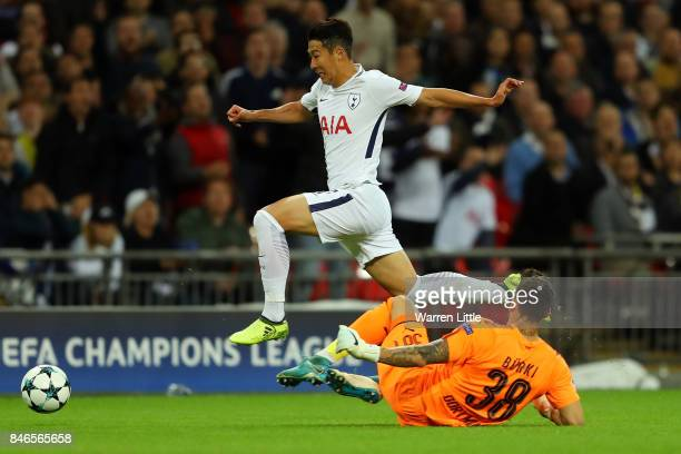 HeungMin Son of Tottenham Hotspur escapes a challenge from Roman Buerki of Borussia Dortmund during the UEFA Champions League group H match between...