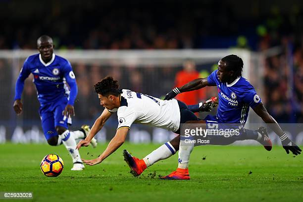 HeungMin Son of Tottenham Hotspur is challenged by Victor Moses of Chelsea during the Premier League match between Chelsea and Tottenham Hotspur at...
