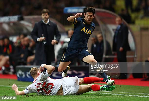 HeungMin Son of Tottenham Hotspur is tackled by Kamil Glik of AS Monaco during the UEFA Champions League Group E match between AS Monaco FC and...