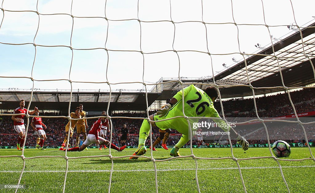 Heung-Min Son of Tottenham Hotspur scores his sides first goal during the Premier League match between Middlesbrough and Tottenham Hotspur at the Riverside Stadium on September 24, 2016 in Middlesbrough, England.