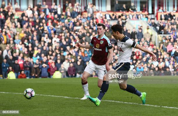 HeungMin Son of Tottenham Hotspur scores his sides second goal during the Premier League match between Burnley and Tottenham Hotspur at Turf Moor on...