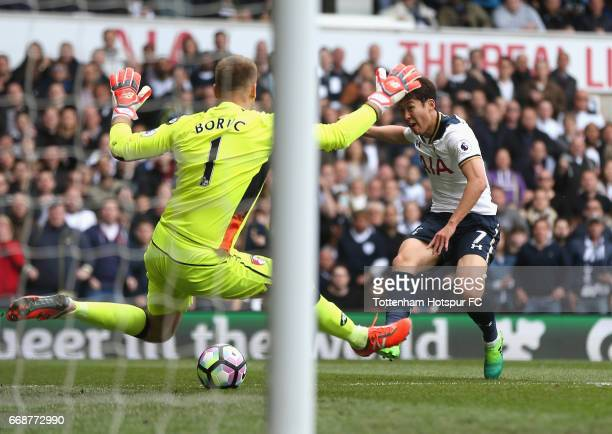 HeungMin Son of Tottenham Hotspur scores his sides second goal during the Premier League match between Tottenham Hotspur and AFC Bournemouth at White...