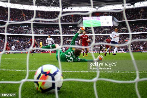 HeungMin Son of Tottenham Hotspur scores his sides second goal past Simon Mignolet of Liverpool during the Premier League match between Tottenham...