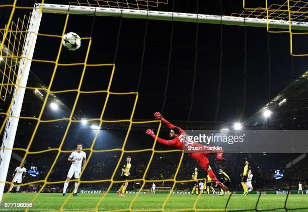 HeungMin Son of Tottenham Hotspur scores his sides second goal past Roman Buerki of Borussia Dortmund during the UEFA Champions League group H match...