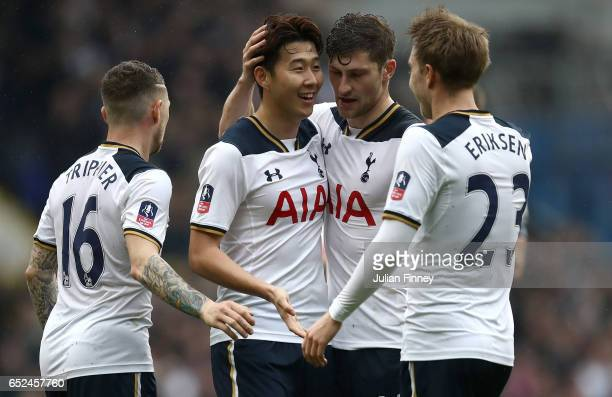HeungMin Son of Tottenham Hotspur scores his sides second goal with his Tottenham Hotspur team mates during The Emirates FA Cup QuarterFinal match...