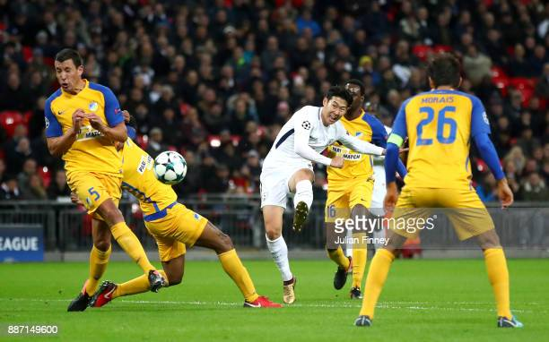 HeungMin Son of Tottenham Hotspur shoots and scores his teams second goal during the UEFA Champions League group H match between Tottenham Hotspur...