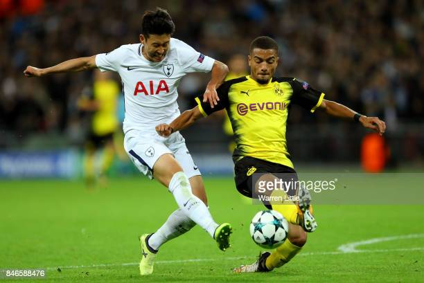 HeungMin Son of Tottenham Hotspur shoots as Jeremy Toljan of Borussia Dortmund challenges during the UEFA Champions League group H match between...
