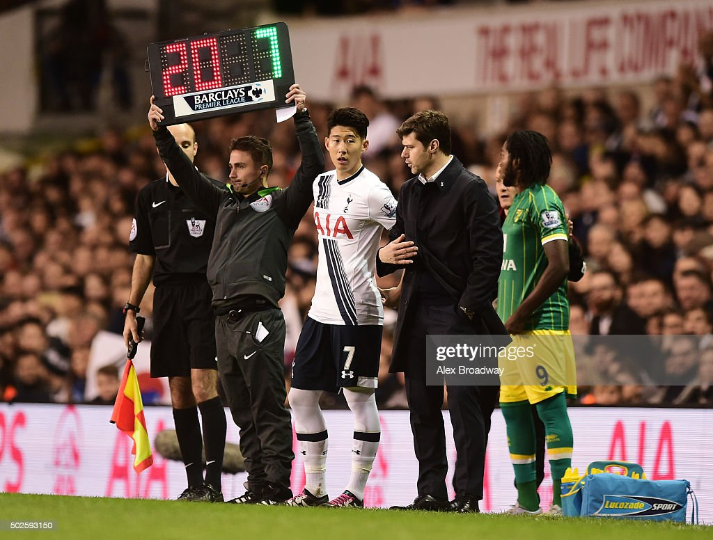 HeungMin Son of Tottenham Hotspur talks to Mauricio Pochettino manager of Tottenham Hotspur as he prepares to come on as a substitute during the...