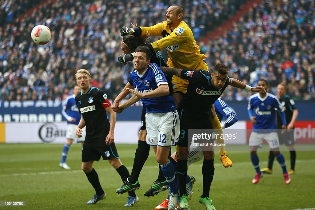Heurelho Gomes of Hoffenheim (R) fits the ball against <a gi-track='captionPersonalityLinkClicked' href=/galleries/search?phrase=Marco+Hoeger&family=editorial&specificpeople=6872414 ng-click='$event.stopPropagation()'>Marco Hoeger</a> of Schalke (L) during the Bundesliga match between FC Schalke 04 and TSG 1899 Hoffenheim at Veltins-Arena on March 30, 2013 in Gelsenkirchen, Germany.