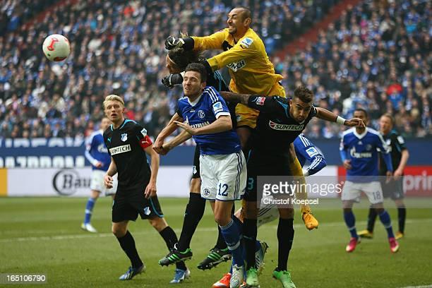 Heurelho Gomes of Hoffenheim fits the ball against Marco Hoeger of Schalke during the Bundesliga match between FC Schalke 04 and TSG 1899 Hoffenheim...
