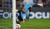 Heurelho Gomes of PSV fails to save a penalty during the UEFA Champions League quarter final second leg match between PSV Eindhoven and Olmpique...