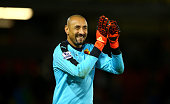 Heurelho Gomes of Watford applauds the supporters after his team's 20 win in the Barclays Premier League match between Watford and Norwich City at...