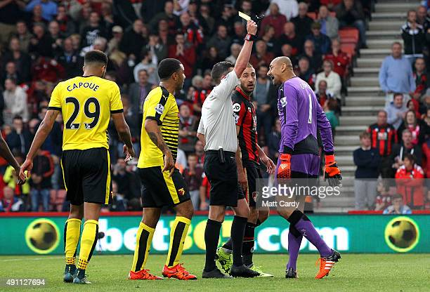 Heurelho Gomes of Watford is shown a yellow card by referee Michael Oliver during the Barclays Premier League match between AFC Bournemouth and...