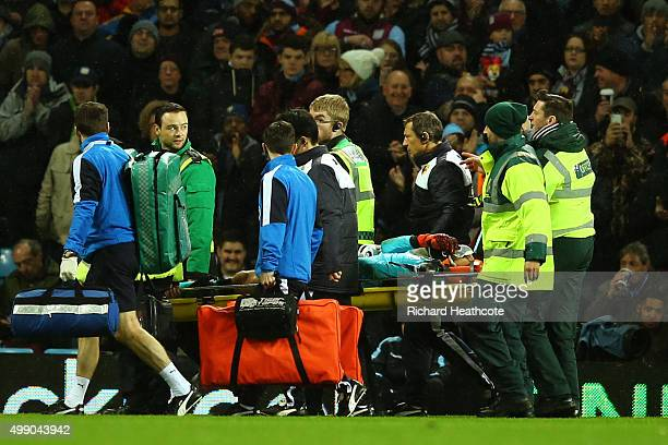 Heurelho Gomes of Watford is taken off by a stretcher after injury during the Barclays Premier League match between Aston Villa and Watford at Villa...