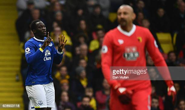 Heurelho Gomes of Watford looks dejected as Romelu Lukaku of Everton celebrates as he scores the first goal during the Premier League match between...