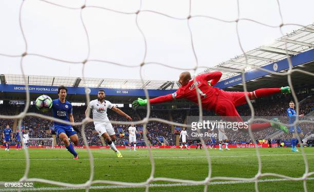 Heurelho Gomes of Watford makes a save during the Premier League match between Leicester City and Watford at The King Power Stadium on May 6 2017 in...