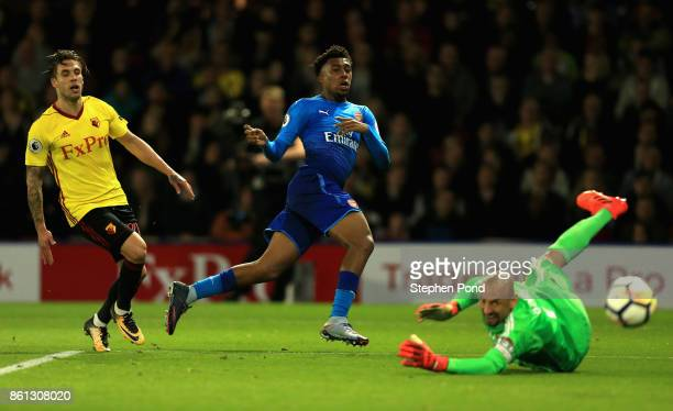 Heurelho Gomes of Watford makes a save from Alex Iwobi of Arsenal during the Premier League match between Watford and Arsenal at Vicarage Road on...