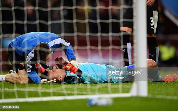 Heurelho Gomes of Watford receives medical treatment during the Barclays Premier League match between Aston Villa and Watford at Villa Park on...