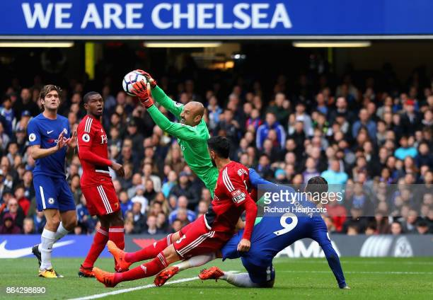 Heurelho Gomes of Watford saves infront of Miguel Britos of Watford and Alvaro Morata of Chelsea during the Premier League match between Chelsea and...