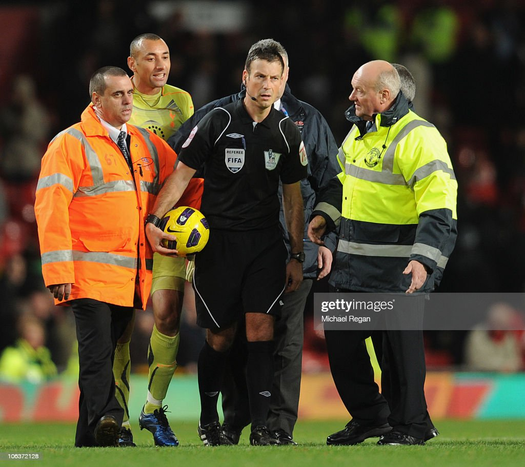 Heurello Gomez of Tottenham argues with referee <a gi-track='captionPersonalityLinkClicked' href=/galleries/search?phrase=Mark+Clattenburg&family=editorial&specificpeople=2108870 ng-click='$event.stopPropagation()'>Mark Clattenburg</a> after the Barclays Premier League match between Manchester United and Tottenham Hotspur at Old Trafford on October 30, 2010 in Manchester, England.