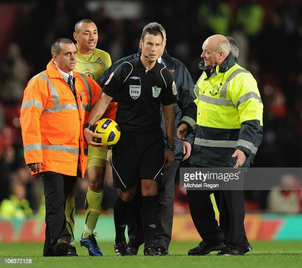 Heurello Gomez of Tottenham argues with referee Mark Clattenburg after the Barclays Premier League match between Manchester United and Tottenham...