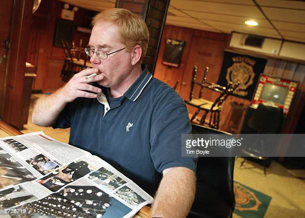 HeurterWilmette Post 46 American Legion commander Mike Jonscher smokes a cigarette while reading a newspaper at the post November 14 2003 in Wilmette...