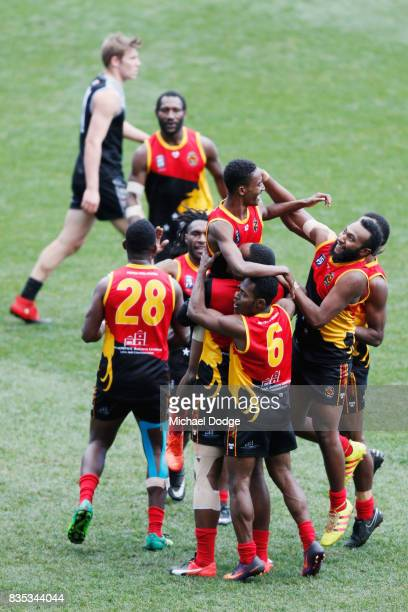 Hewago Paul OEA of Papua New Guinea celebrates a goal with teammates during the 2017 AFL International Cup Grand FInal match between New Zealand and...