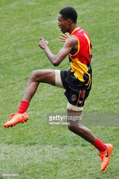 Hewago Paul OEA of Papua New Guinea kicks the ball for a goal during the 2017 AFL International Cup Grand FInal match between New Zealand and Papua...