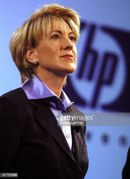 HewlettPackard CEO Carly Fiorina listens to a question during a press conference to announce the merger of HP with Compaq Computers 04 September 2001...