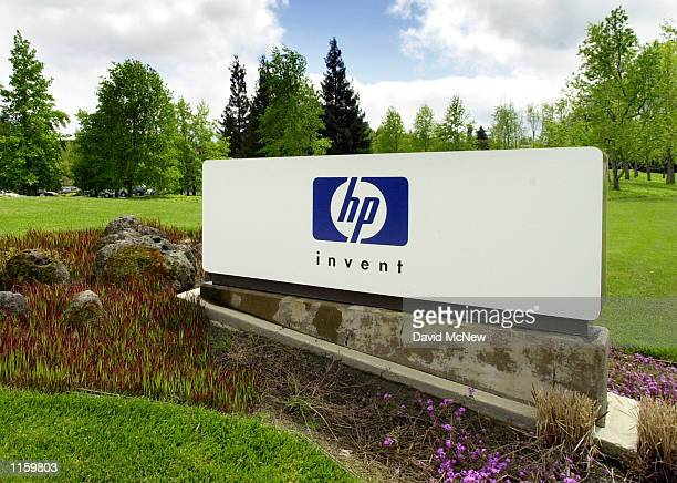 A HewlettPackard sign stands outside the company's headquarters April 20 2001 in Palo Alto California HewlettPackard Co announced September 3 2001...