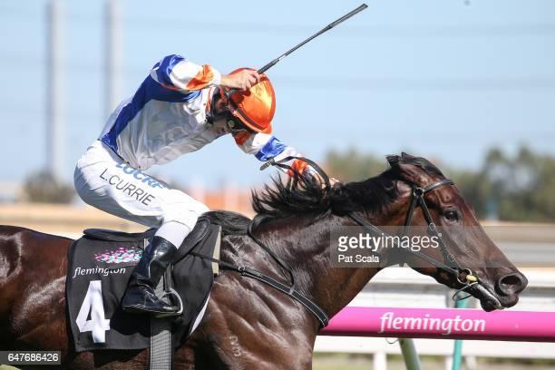 Hey Doc ridden by Luke Currie wins the Australian Guineas at Flemington Racecourse on March 04 2017 in Flemington Australia
