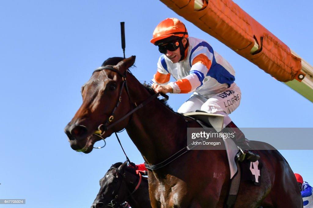 Hey Doc ridden by Luke Currie wins the Australian Guineas at Flemington Racecourse on March 04, 2017 in Flemington, Australia.