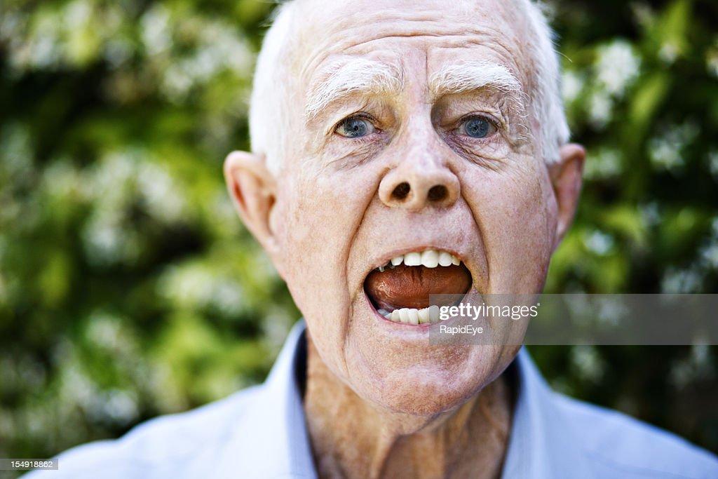 Hey! Furious old man yells at camera : Stock Photo