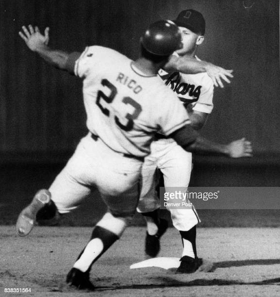 Hey Ronnie that's no Way to Act Second baseman Ronnie Theobald of the Denver Bears looks as though he has just slapped Omaha base runner Fred Rico in...