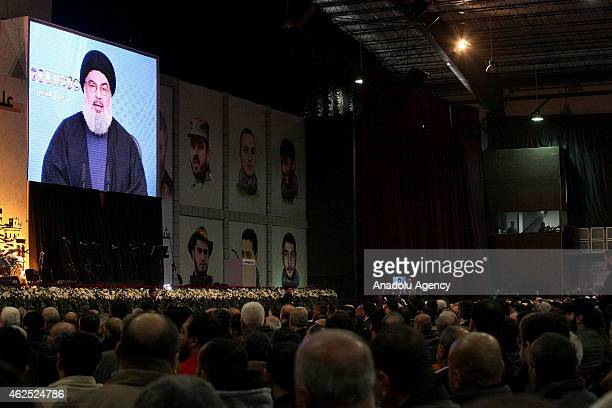 Hezbollah chief Hassan Nasrallah speaks via video conference during the commemoration ceremony for killed militants of Hezbollah in Syria on January...