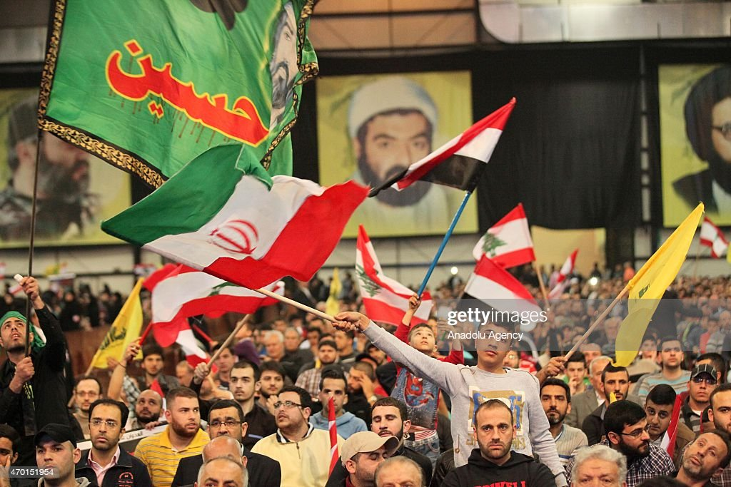 Hezbollah chief Hassan Nasrallah speaks via video conference in Beirut on April 17, 2015 during a meeting in support of Yemeni people.