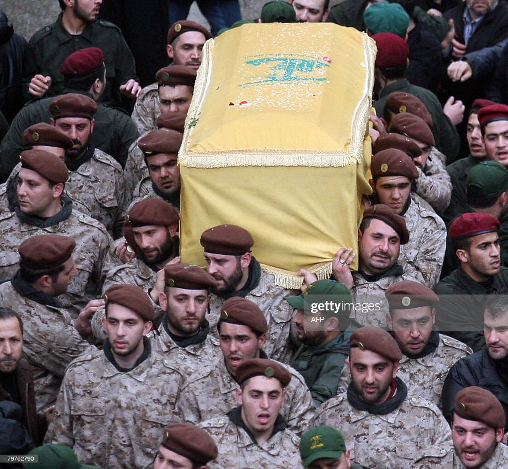 Hezbollah commandos carry the coffin of their slain commander Imad Mughnieh during his funeral in Beirut's southern suburbs on February 14 2008...