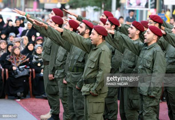 Hezbollah fighters parade during a ceremony organized by the militant Shiite Muslim group on the occasion of Martyr's Day in the southern suburbs of...