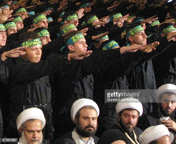 Hezbollah fighters salute during a graduation ceremony on 'Martyrs Day' in Beirut 11 November 2001 Lebanon called on Washington 10 November to remove...