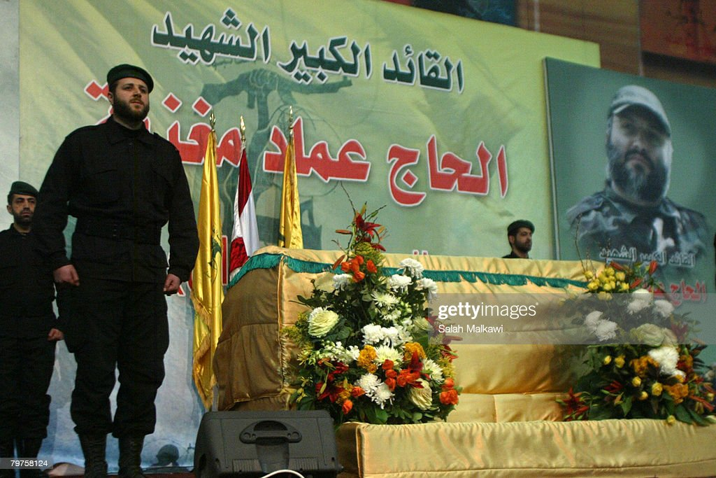 Hezbollah guerrillas pay respect to assassinated commander Imad Moughniyeh at his funeral on February 14 2008 in a suburb of Beirut Lebanon Thousands...