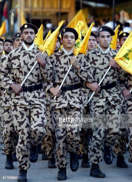 Hezbollah militants march during a rally marking Jerusalem Day in Baalbek eastern Lebanon 12 November 2004 Hezbollah chief Sheikh Hassan Nasrallah...