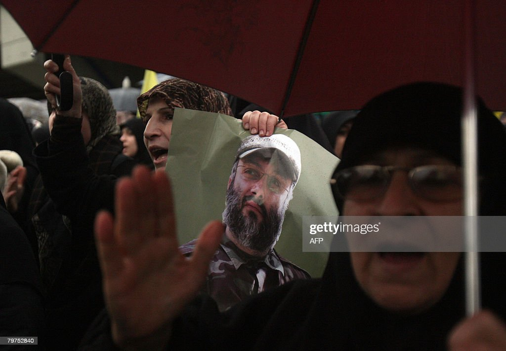 Hezbollah supporters shout antiIsrael slogans in the southern suburbs of Beirut during the funeral of slain Hezbollah commander Imad Mughnieh on...