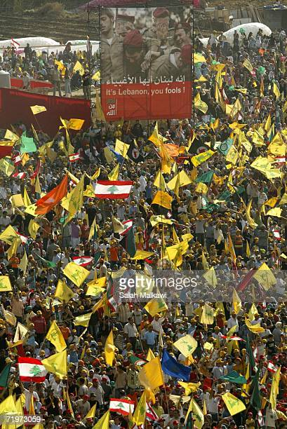 Hezbollah supporters wave flags during a Hezbollah 'victory over Israel' rally in Beirut's suburbs September 22 2006 in Beirut Lebanon According to...