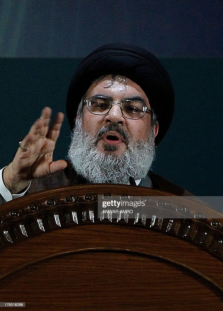 Hezbollah's chief Hassan Nasrallah (C) delivers a speech during a rare public appearance at a gathering to mark the 'Al-Quds (Jerusalem) International Day' from Beirut's southern suburb neighbourhood of Rweiss on August 2, 2013. It was a first appearance in public since last September for Nasrallah, public enemy number one for Israel and a staunch ally of Syrian President Bashar al-Assad whose troops have been battling an insurgency since 2011.