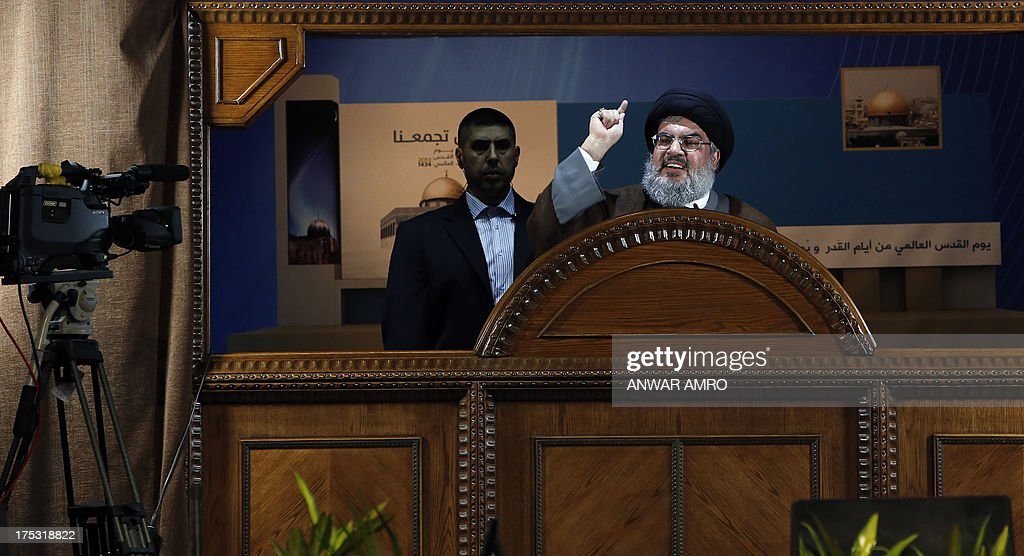 Hezbollah's chief Hassan Nasrallah (C) delivers a speech during a rare public appearance at a gathering to mark the 'Al-Quds (Jerusalem) International Day' from Beirut's southern suburb neighbourhood of Rweiss on August 2, 2013. It was a first appearance in public since last September for Nasrallah, public enemy number one for Israel and a staunch ally of Syrian President Bashar al-Assad whose troops have been battling an insurgency since 2011. AFP PHOTO/ANWAR AMRO