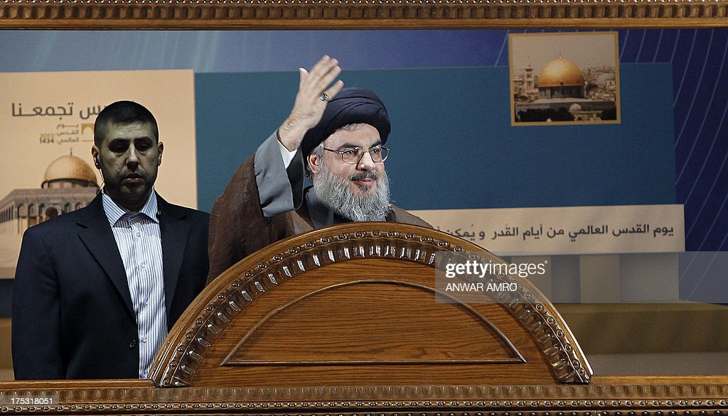 Hezbollah's chief Hassan Nasrallah (C) gestures during a rare public appearance at a gathering to mark the 'Al-Quds (Jerusalem) International Day' from Beirut's southern suburb neighbourhood of Rweiss on August 2, 2013. It was a first appearance in public since last September for Nasrallah, public enemy number one for Israel and a staunch ally of Syrian President Bashar al-Assad whose troops have been battling an insurgency since 2011.