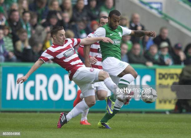 Hibernian Danny Haynes and Hamilton's Jon Routledge during the Scottish Premiership Play Off final at Easter Road Edinburgh