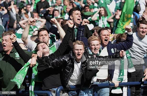 Hibernian fans celebrate at the final whistle as Hibernian beat Rangers 32 during the William Hill Scottish Cup Final between Rangers FC and...