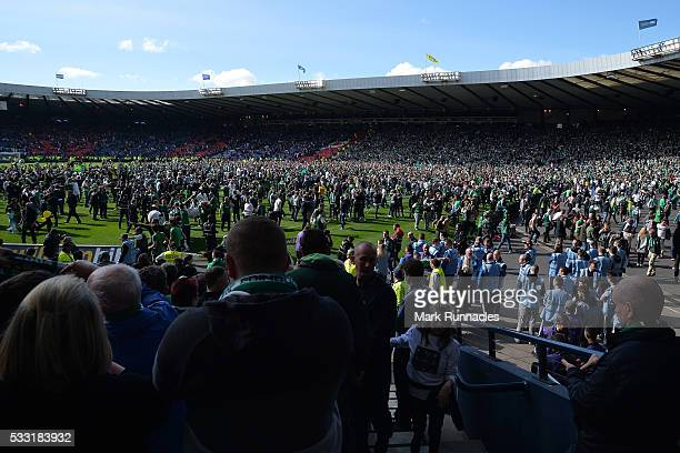 Hibernian fans invade the Hampden Park Pitch at the final whistle as Hibernian beat Rangers 32 during the William Hill Scottish Cup Final between...