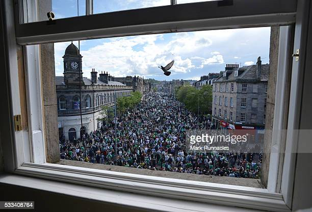 Hibernian fans wait on Leith Walk ahead of the Hibernian FC team parading the Scottish Cup to their fans on an open top bus along Leith Walk on May...